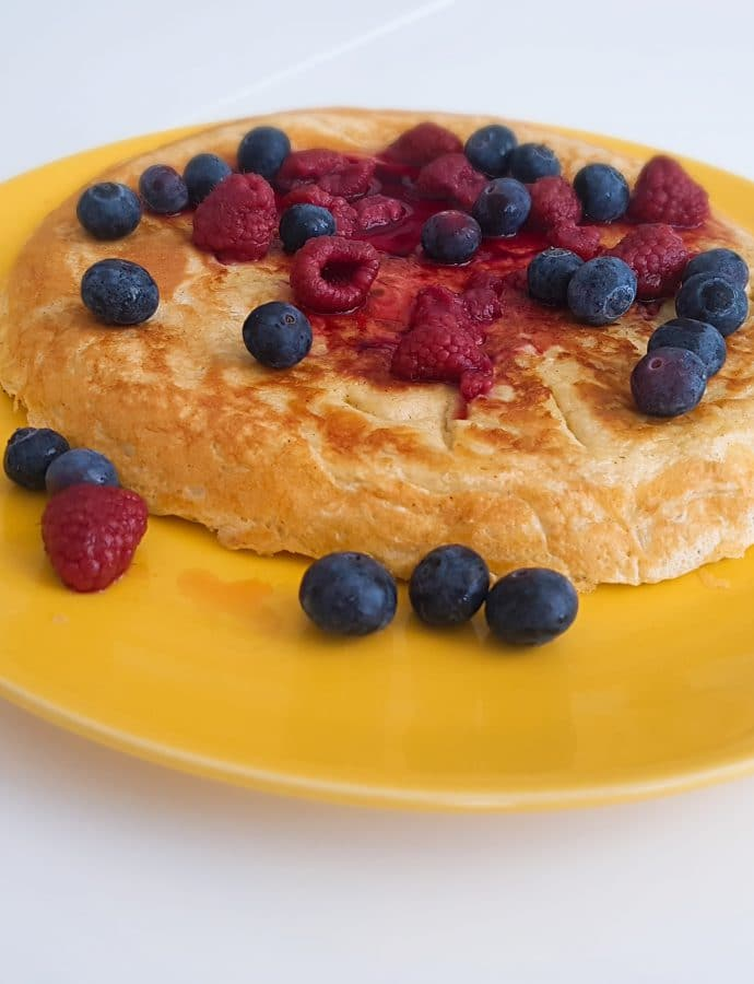 Banana omelette with raspberries and blueberries