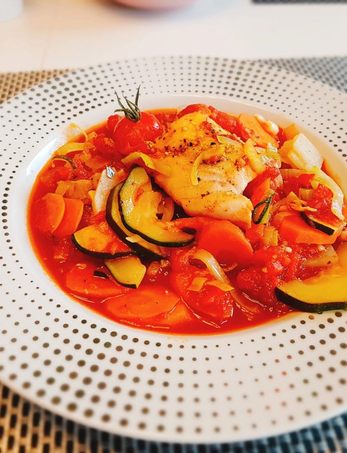 Cod loin on vegetables in tomatoes and pepper sauce
